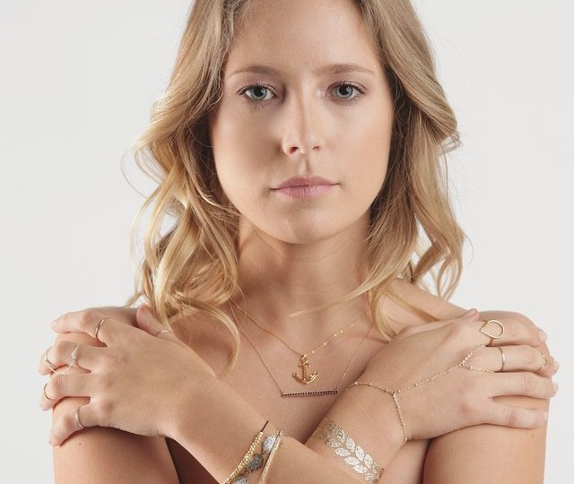 TBT the gorg @epdutra rocking several of our pieces for @greenleeswim by @johnallenphillipsphoto #14kgold #bands #blackdiamond #bars #necklaces #bracelets #anchor #charms #alexisjewelry